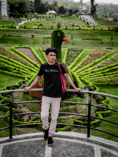Portrait of man standing on landscape