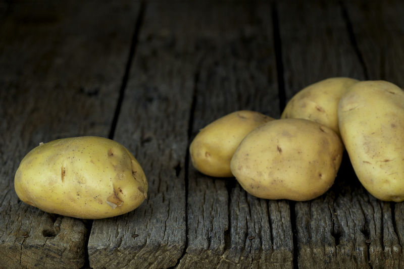 Potato Wooden Fresh Potatoes Background Table Old Food Raw Nutrition Wood Harvest Healthy Vegetable Organic Agriculture Rustic Brown Pile Ingredient Root Vegetarian Natural Farm Top View Group Heap Sack Diet Produce Many Yellow Cooking Dark Rural Uncooked Burlap Tuber Dirty Food And Drink Healthy Eating Wellbeing Freshness Wood - Material Raw Potato No People Still Life Close-up Raw Food High Angle View Indoors  Group Of Objects Vegetarian Food