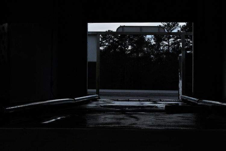 Absence Alone Black And White Car Wash Creepy Dark Empty Mystery Narrow Odd Old Public Scary Suspense Trees Wet Background Outdoors Erry