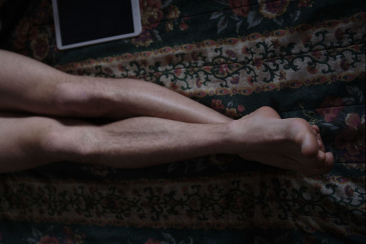Human Body Part One Person Body Part Low Section barefoot Human Leg Real People Human Hand Lifestyles Indoors  Hand Wall Adult Relaxation Men Communication Human Foot Limb Brick Human Limb Finger Legs Long Nacked Ipad