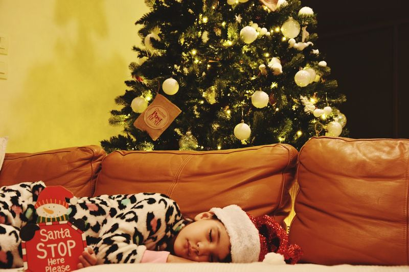 EyeEm Selects Holiday Christmas Tree christmas tree Celebration Furniture Indoors  Home Interior Lying Down Decoration Sleeping Childhood Christmas Decoration