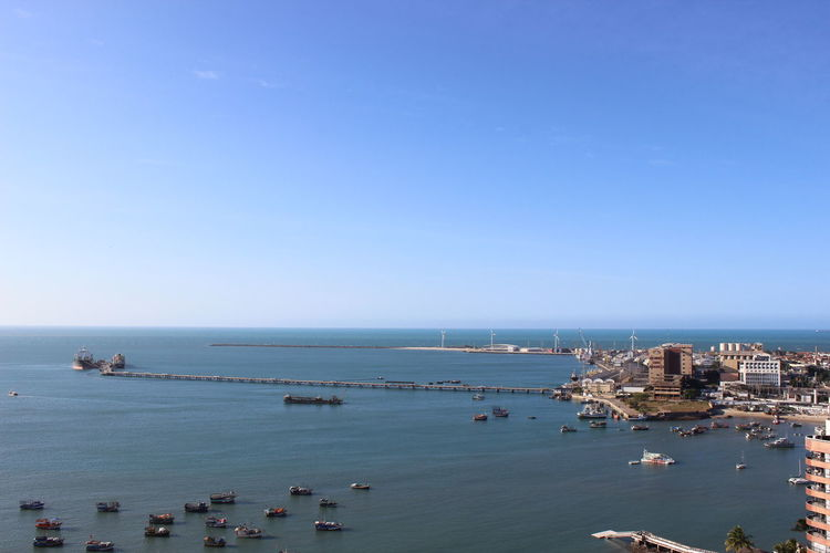 High Angle View Of Boats Moored On Sea By Harbor