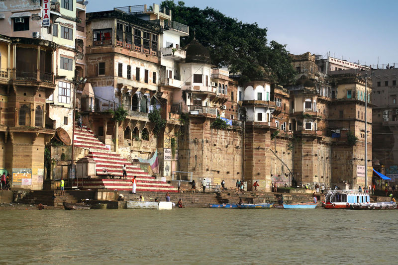 The Ganges Varanasi, India Ganges, Indian Lifestyle And Culture, Bathing In The Ganges, Architecture Building Exterior Built Structure Religion And Beliefs Sacred The Ganges River Travel Destinations