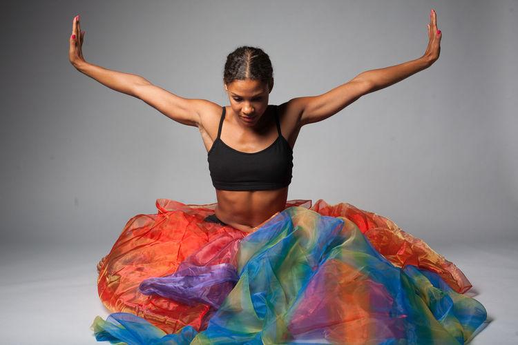 Portrait Of Dancer Wearing Multi Colored Skirt