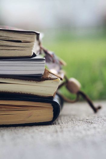 Read between the lines Stack Book Still Life Close-up Heap No People Wisdom Nature Outdoors