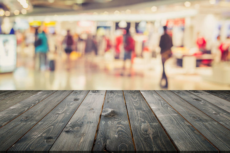 Close-up of people on wooden floor