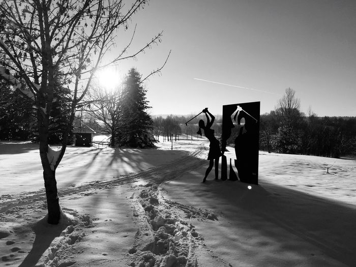 Sculpture of golfer on snow covered landscape