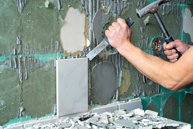 Man working on wall