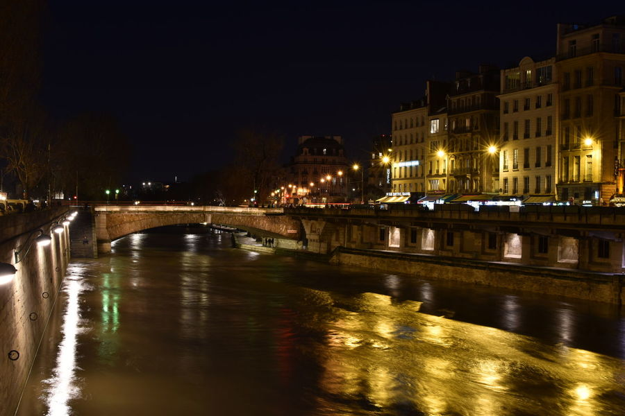 River Seine Paris Nightphotography Along The Riverside Night Illuminated Architecture Cityscape Building Exterior City Bridge - Man Made Structure Travel Destinations Reflection Outdoors River No People Water