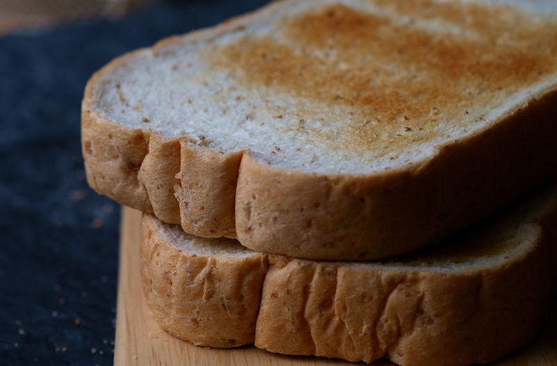 Close-up of toasted bread on cutting board