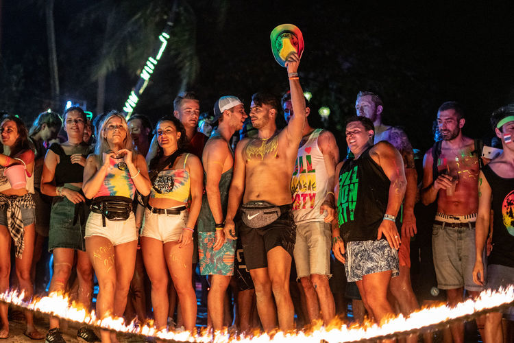 Let the Party Begin Colorful Colors Clothing Beach Shorts Party Rope Fire Arms Raised Hat Night Nightlife Human Arm Celebration Enjoyment Large Group Of People Crowd Real People Group Of People Burning Glowing Fire Light Friends Fun Enjoying Life My Best Photo