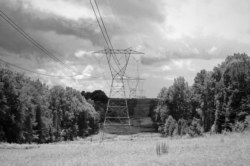 Power Lines Power Towers Blackandwhite Bwphotography Blackandwhite Photography Clouds And Sky Cloudy Bwphotooftheday Highvoltage