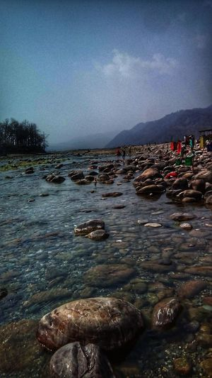 scenery view Water Water_collection Water Reflections Stones & Water Stone Water River View River Evening Pebbles Mountains Mountain Range Mountain View Clouds And Sky Ramnagar India Indiapictures EyeEmNewHere Eye4photography