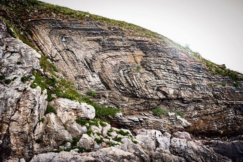 Rock - Object Sky Landscape Mountain Cliff Nature Cloud - Sky No People Outdoors Travel Destinations Scenics Day Beauty In Nature Beauty In Nature Rock Formation Fold Geology Geological Formation Geological Landscape Thrust Fault Devonian Devon Classic Geology