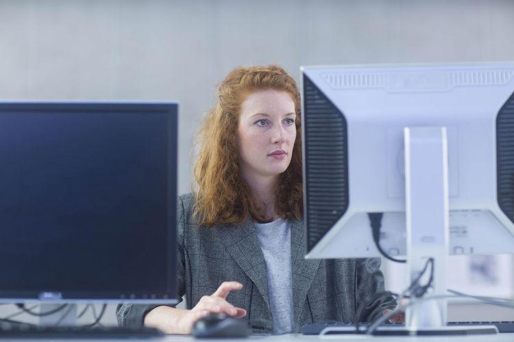 Portrait of senior woman working in office
