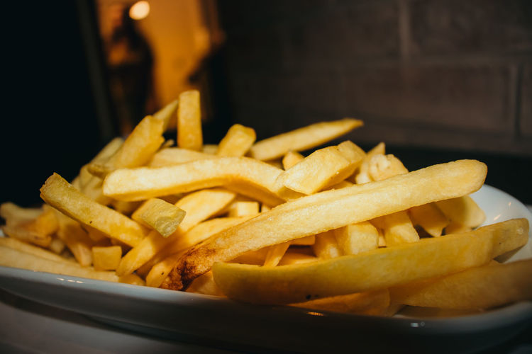 French Fries Prepared Potato Potato Fast Food Ready-to-eat Food Food And Drink Fried Unhealthy Eating Freshness Snack Close-up Deep Fried  Indoors  Still Life Selective Focus No People Serving Size Focus On Foreground Table Comfort Food Fast Food French Fries French Food Temptation Tray