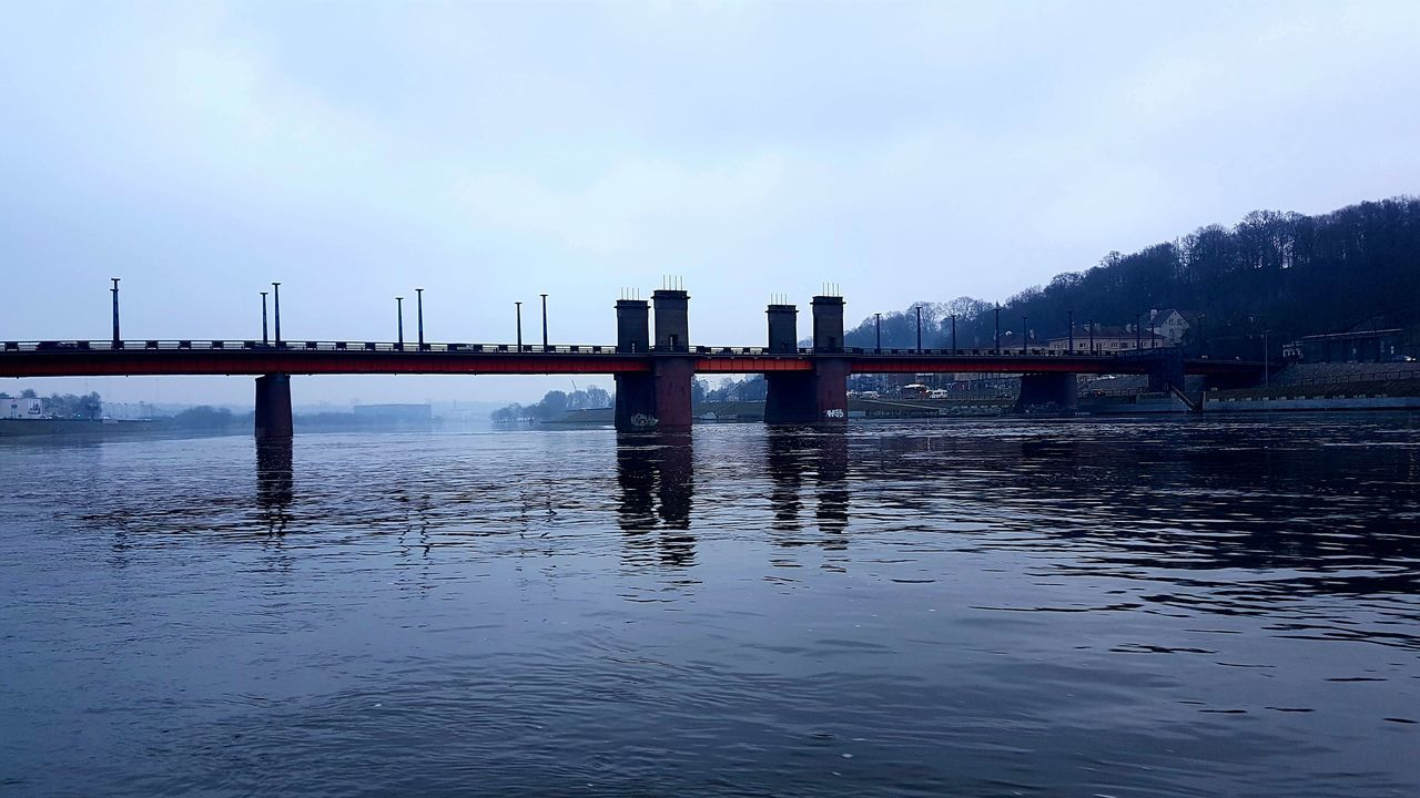 sky, built structure, architecture, connection, water, outdoors, no people, waterfront, bridge - man made structure, day, cloud - sky, nature, building exterior