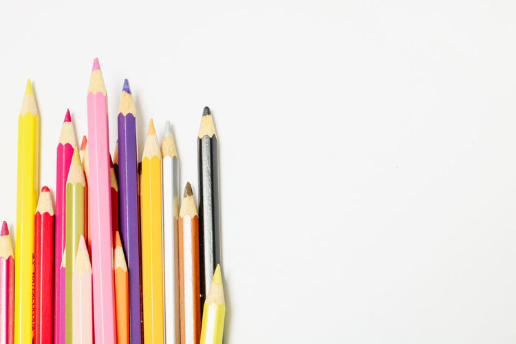 Multi Colored Pencil White Background Studio Shot Writing Instrument Art And Craft Variation Copy Space Still Life Indoors  Large Group Of Objects Creativity No People Choice Colored Pencil Craft Close-up Collection Education High Angle View Art And Craft Equipment