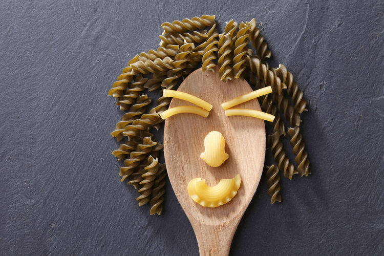 Directly above shot of pastas and spoon on slate