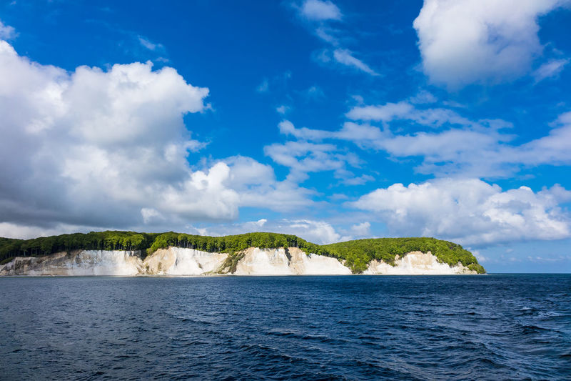 Scenic View Of Mountain In Baltic Sea Against Blue Sky