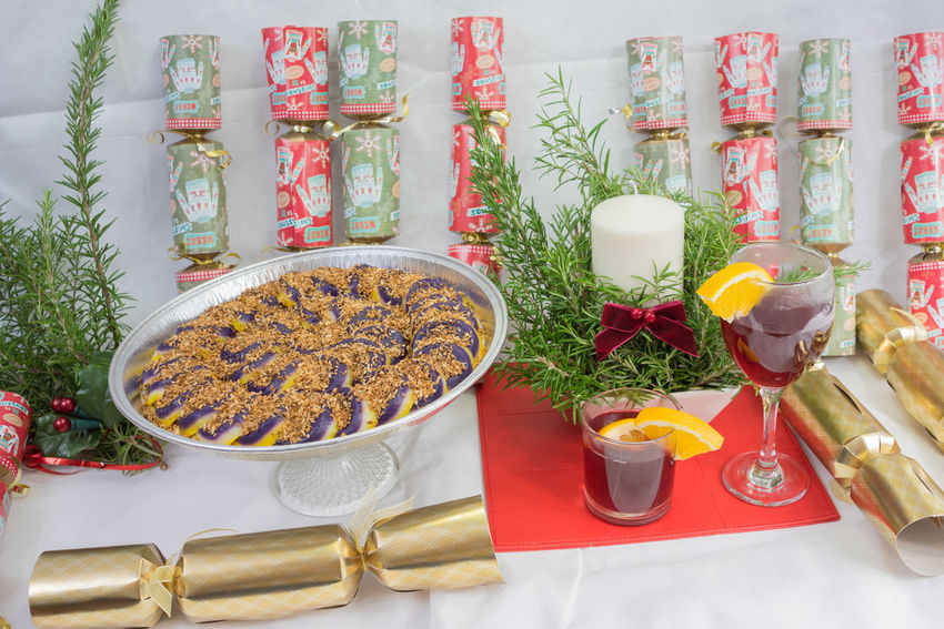 Christmas display with a Filipino purple yam display Christmas Christmas Crackers Christmas Decoration Evergreens Fruits Lover Glass Of Wine On A Special Day White Back Drop Yam Purple Sweets Filipino
