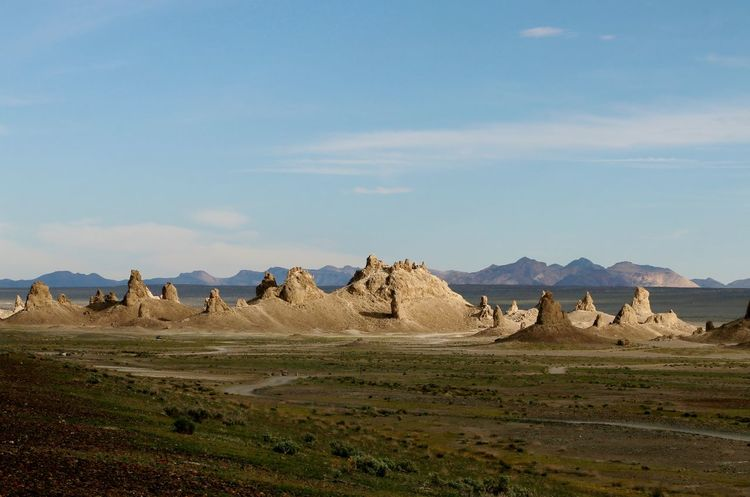 Underwater formations in dried up lake Desert Pinnacles Rock Formations Arid Climate Beauty In Nature Day Dried Up Lake Geology Landscape Mountain Mountains Nature No People Outdoors Scenics Sky Sunlight And Shadow Tranquil Scene Tranquility Trona Pinnacles