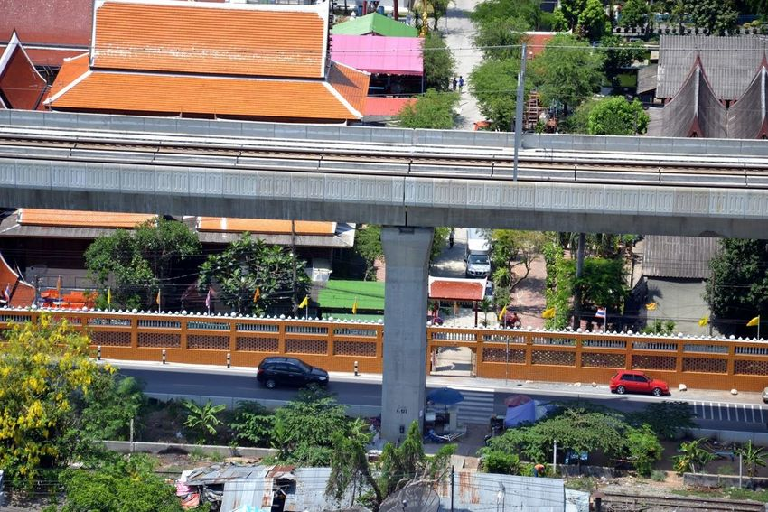 Bangkok's Skytrain line to Suvarnabhumi Airport (BKK) Suvarnabhumi Airport Architecture Bridge - Man Made Structure Building Exterior Built Structure Bus Car City City Life Day High Angle View Land Vehicle Old And The New Outdoors Real People Road Skytrain BTS Skytrainbangkok Transportation Tree