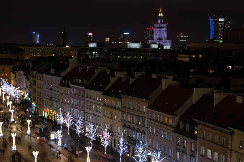 Poland Warsaw Europe Building Exterior Built Structure Architecture Night City Illuminated Building Group Of People Crowd Large Group Of People Real People High Angle View City Life Women Men Outdoors Cityscape Street Nightlife Consumerism