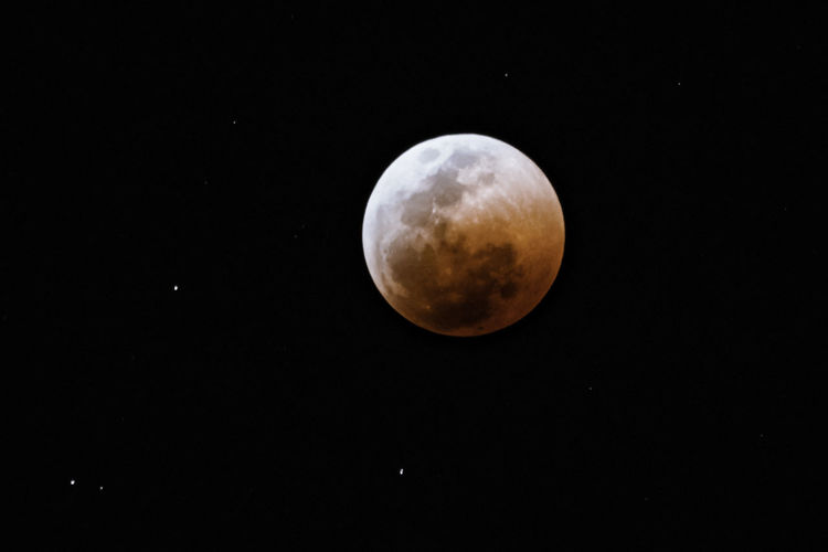 The moon half way through the longest lunar eclipse of the century. Astrology Astronomy Beauty In Nature Circle Copy Space Eclipse Full Moon Geometric Shape Idyllic Moon Moon Surface Moonlight Nature Night No People Outdoors Planetary Moon Scenics - Nature Shape Sky Space Space And Astronomy Sphere Tranquility