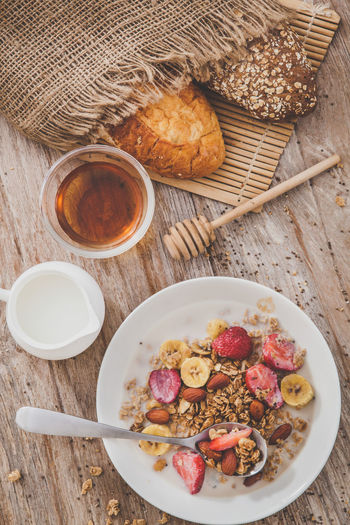 Black spaghetti with shrimps and sausage Almond Berry Breakfast Cereal Cornflakes Cuisine Diet Food Fruit Grain Healthy Homemade Ingredient Milk Morning Muesli Nutrition Oat Strawberry