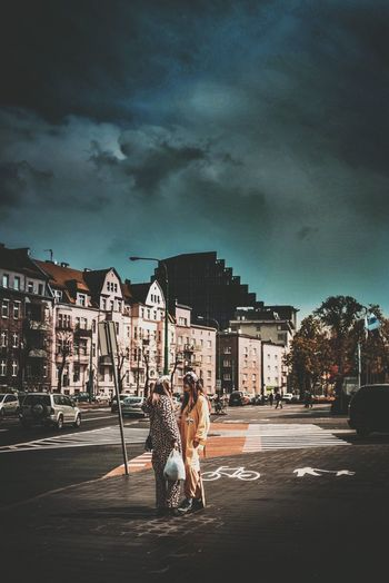 The Photojournalist - 2017 EyeEm Awards Building Exterior Built Structure Togetherness Architecture City Two People Street Young Women Young Adult Sky City Life Cloud - Sky The Week On Eyem EyeEm Best Edits EyeEm Gallery Live For The Story The Great Outdoors - 2017 EyeEm Awards Outdoors Bonding Leisure Activity Women Real People Couple - Relationship EyeEm Selects