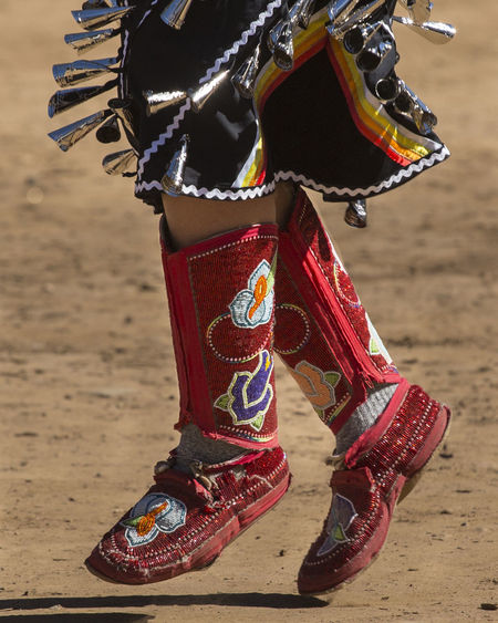 Dancing Feet Traditional Culture Celebration Event Close-up Costumes Cultures Dancing Girl Dancng Day Feet On The Ground Focus On Details Lifestyles Leisure Activity Mocassins Multicolors  One Person Outdoors Powwow Real People Standing Traditional Clothing Traditional Festival
