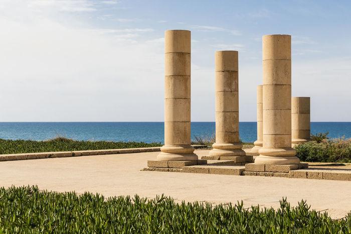 Caesarea Maritima, Israel Antique Archeological Park Archeological Site Caesarea Caesarea's Antiquities Park Column Day Israel Mediterranean Sea No People Outdoors Sea Sky Sunlight Water