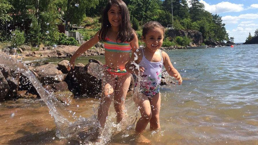 Splash... Paradise Beach Coastline Laughter Is The BEST Medicine Laughing Girls Water Childhood Smiling Fun Elementary Age Two People Family Togetherness Portrait Leisure Activity Looking At Camera Lifestyles Vacations Happiness Real People Child Enjoyment Outdoors