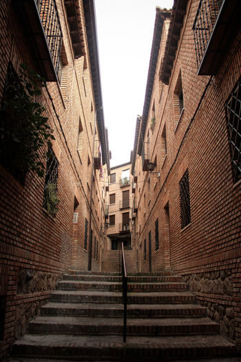 Alley in the old town of Toledo, Spain. Brick Wall Cute Houses Old Town SPAIN Soft Light Spanish History Spanish Town Toledo Spain Alley Alleyway Architecture Brick Alley Wall Building Exterior Built Structure Dark Alley Historical Place Mysterious Mysterious Alley Narrow Alley Romantic Alley Spanish Culture Staircase Toledo Travel Spain Travelling Photography