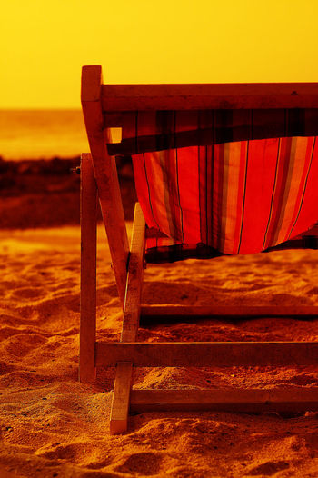 Beach Beach Chair Beach Chairs Beauty In Nature Day Horizon Over Water Nature No People Orange Color Outdoors Sand Scenics Sea Sky Sunset Water Wood - Material