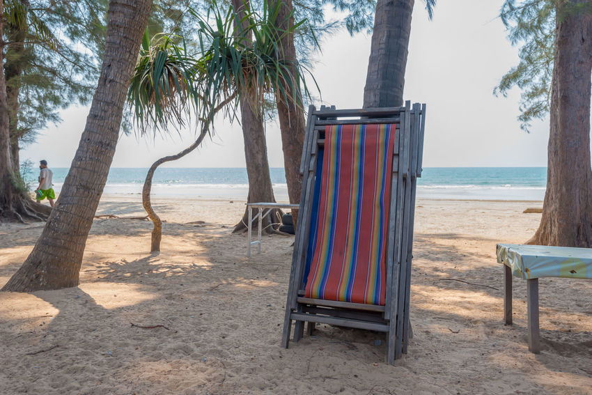Isolated beach chairs on a beach in Thailand Samed Thailand Travel Photography Beach Beauty In Nature Day Horizon Over Water Nature No People Outdoors Sand Scenics Sea Shore Sky Tourism Tranquility Travel Destinations Tree Tree Trunk Water