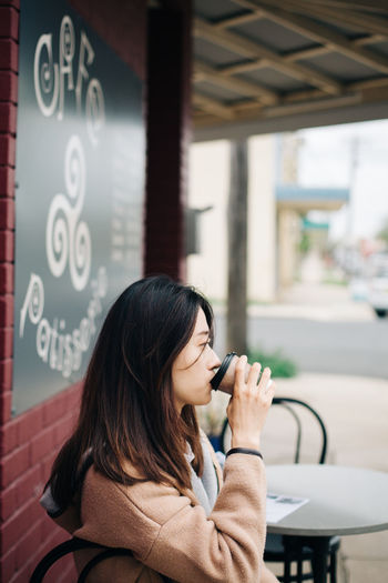 Focus On Foreground Women One Person Real People Adult Indoors  Casual Clothing Sitting Young Adult Communication Young Women Long Hair Table Hairstyle Lifestyles Hair Business Portrait People Travel The Portraitist - 2019 EyeEm Awards The Traveler - 2019 EyeEm Awards