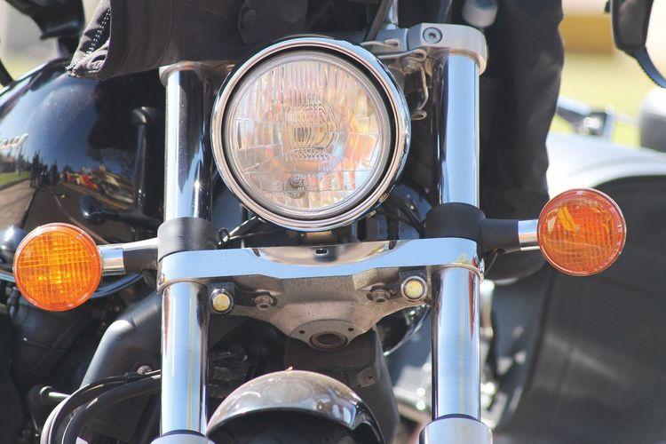 Close-up of motorbike headlight