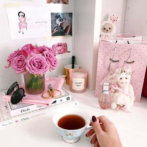Flower Flowering Plant Indoors  One Person Pink Color Table Home Interior Cup Plant Mug Representation Holding Human Body Part Animal Representation Human Hand Lifestyles Hand Food And Drink Drink Real People