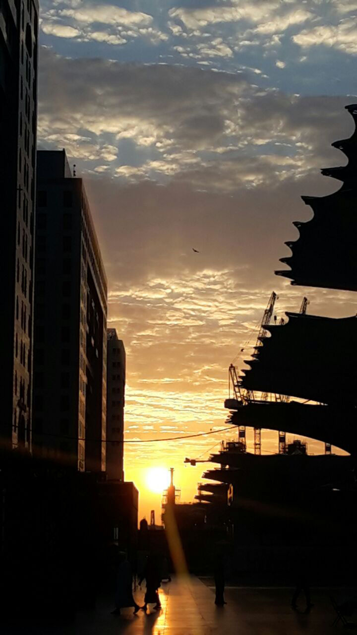 sunset, sky, architecture, silhouette, cloud - sky, built structure, building exterior, city, sun, outdoors, sunlight, real people, skyscraper, nature, day