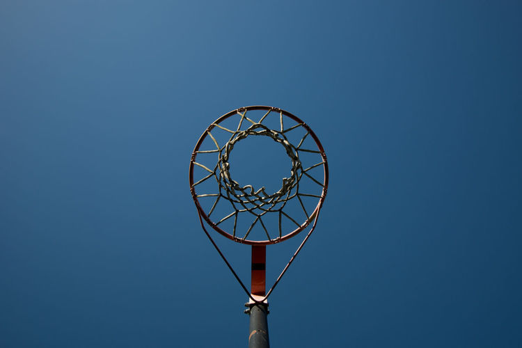 Aspirations Basketball Basketball - Sport Basketball Hoop Blue Day Leisure Games Looking Up Low Angle View Netball Netball Basket Netball Hoop No People Outdoors Sky Sport Taking A Shot - Sport Underneath