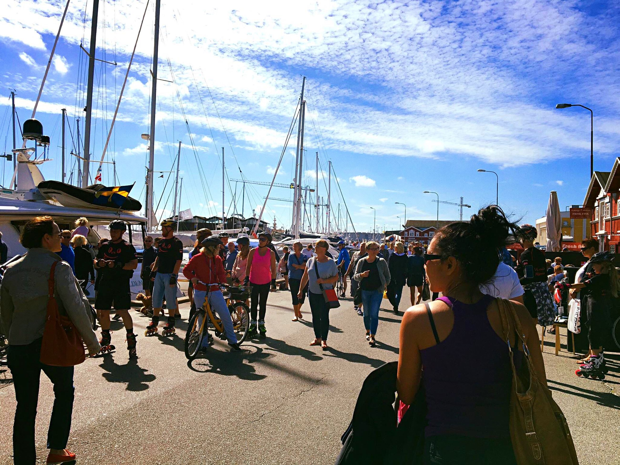 large group of people, sky, men, person, walking, standing, cloud - sky, full length, mast, day, casual clothing, cloud, city life, crowd, weekend activities
