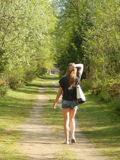 walk along a path Adult Adults Only Adventure Day Freedom Full Length Green Human Body Part Model Nature One Person One Woman Only Only Women Outdoors Path People Person Rear View Teenager Trail Tree Uniqueness Women Young Adult Youth EyeEmNewHere Miles Away Women Around The World