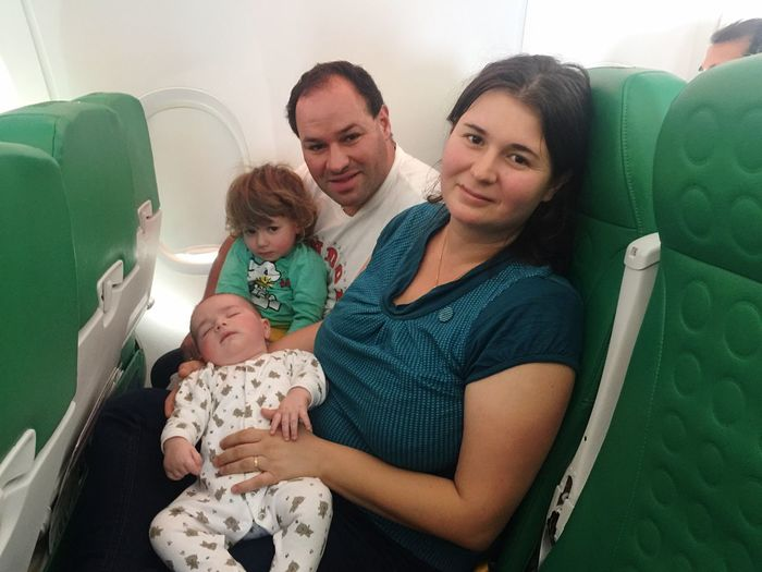 Family Traveling In Airplane