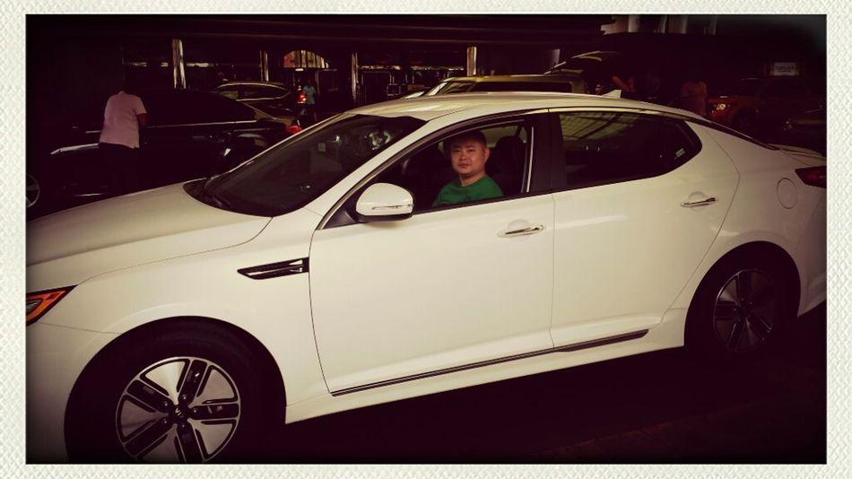 Mark in his new kia optima hybrid