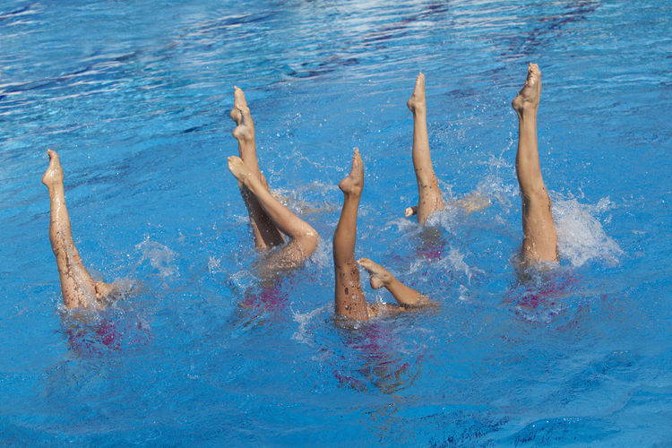Synchronized swimming. Grace Choreography Clear Blue Water Competition Endurance Exercising Feet In The Air Legs Legs In The Air Motion Pool Position Sport Sports Sportswoman Strenght Swimmer Swimming Swimming Pool Synchronized Synchronized Swimming Synchronized Swimming Choreography Water Woman Sport