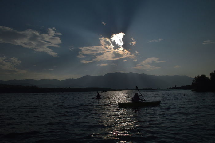 Cloud Kayaking Lost In The Landscape Lake Mountain Range One Person Sky Sun Beams Water