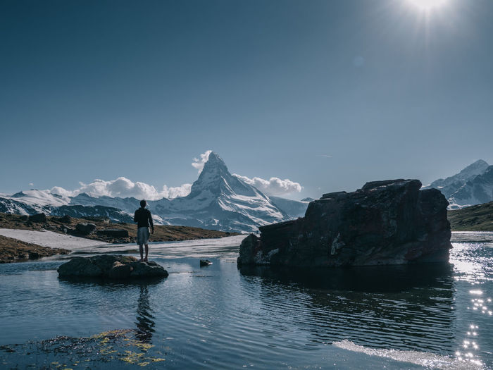 Matterhorn  Zermatt Wallis Toblerone Chocolate Mountain Mountain Scenics - Nature Sky Beauty In Nature Water Snow Real People Tranquil Scene Cold Temperature Tranquility Mountain Range Non-urban Scene Nature Winter Idyllic Day One Person Standing Snowcapped Mountain Outdoors Ice