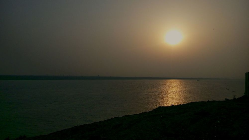 Sunrise Silhouette Sky No People Beauty In Nature Sun River Ganga Peaceful View Water Sunlight Reflection Outdoors Landscape Riverside Photography GoodMorningWorld